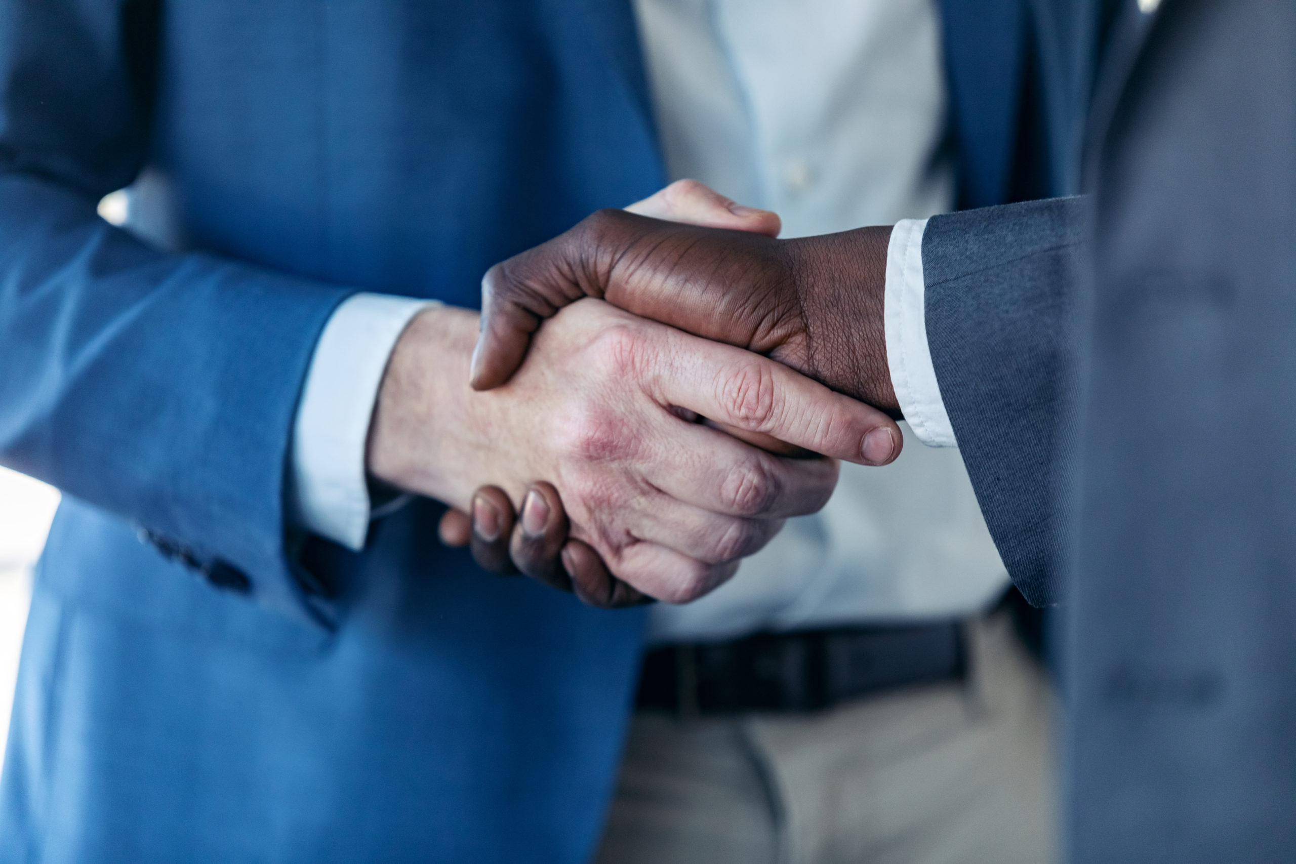 close up view of business partner handshaking proc 4BUCSC7 scaled
