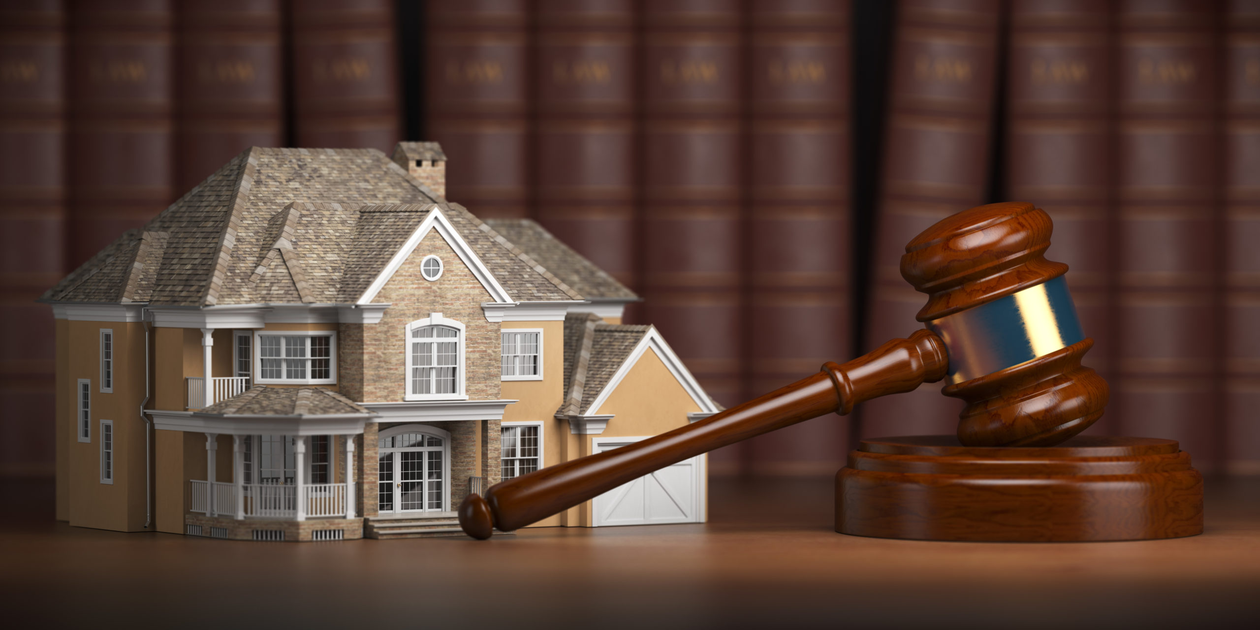 house with gavel and law books real estate law and XM3QZCA scaled